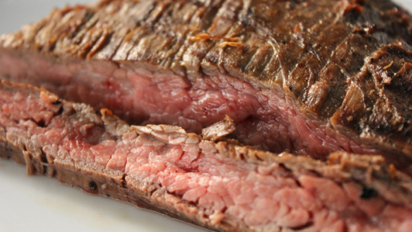 close up of flank steak cooked medium