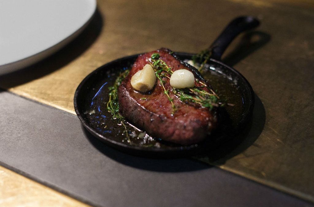 Recipe: Dry aged rump cap with smoked wagyu fat mash, roast mushrooms and black garlic oil