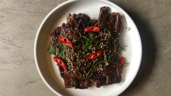 korean kalbi short ribs on a white plate