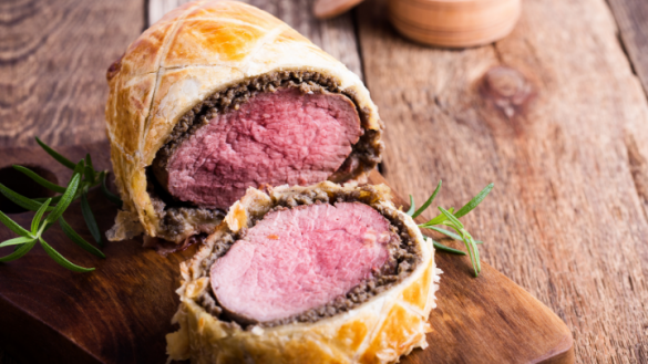 beef wellington carved on a wooden board