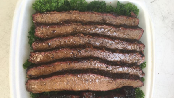 A plate of six barbecued beef brisket slices