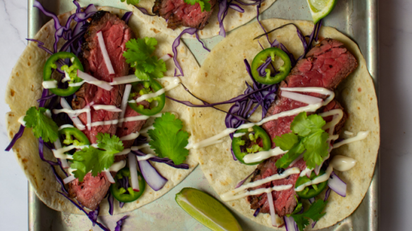 carne asada tacos with a drizzle of mayonnaise